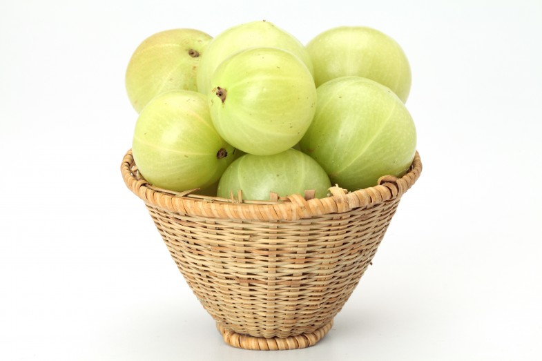 Fresh gooseberries on white background