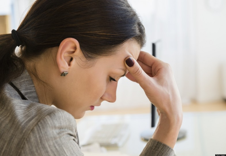Businesswoman frustrated at desk