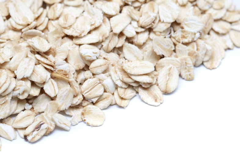 Closeup view of healthy rolled oats used as an ingredient in many cereals, in particular muesli and granola