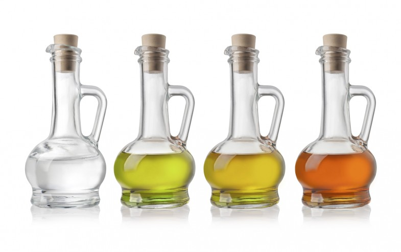 Glass Bottles Of Oil And Vinegar On White Background