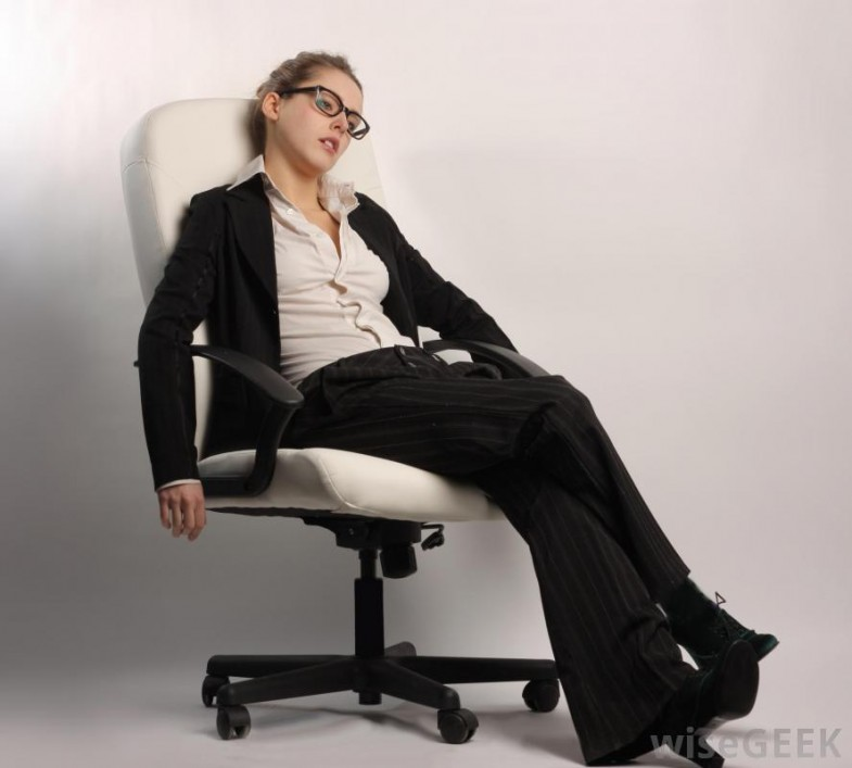 tired-woman-in-suit-sitting-on-chair