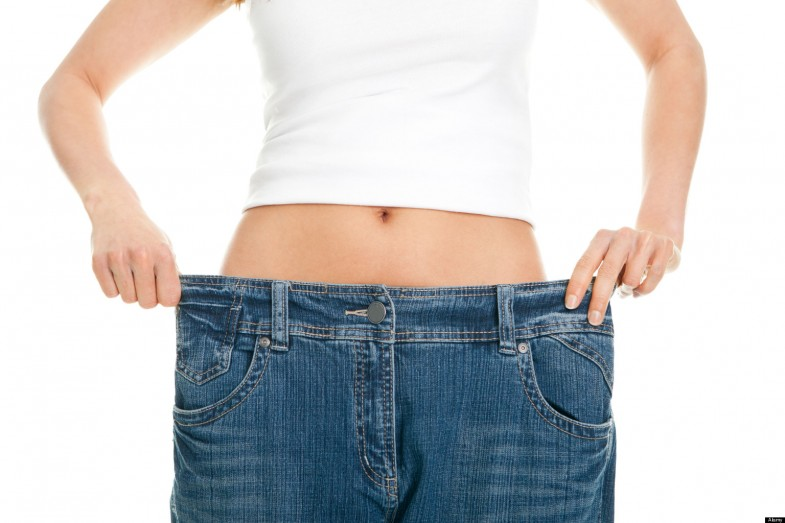CYYWFK Slim woman pulling oversized jeans. Weight loss concept. Isolated on white