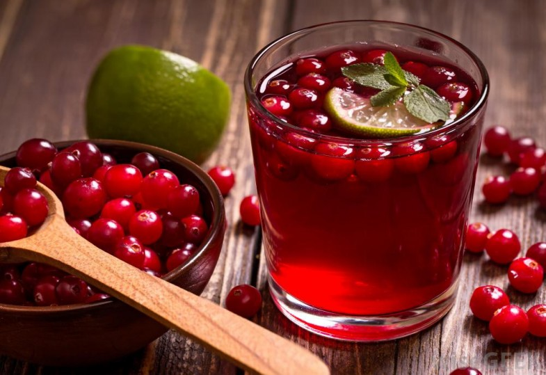 glass-of-cranberry-juice-near-bowl-of-and-spoon